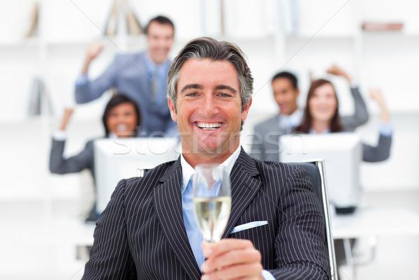 Jómódú menedzser csapat iszik pezsgő iroda Stock fotó © wavebreak_media