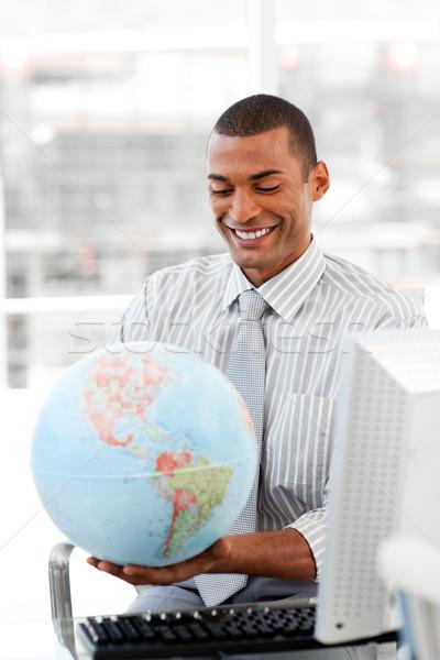 Gülen işadamı dünya ofis iş Stok fotoğraf © wavebreak_media