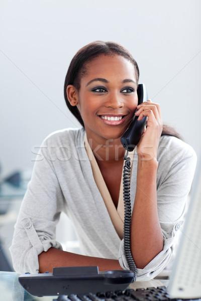 Bright Afro-american businesswoman talking on a phone  Stock photo © wavebreak_media