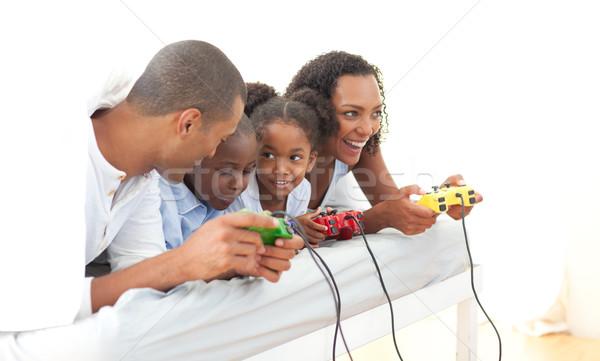 Stock fotó: élénk · család · játszik · videojáték · fekszik · ágy