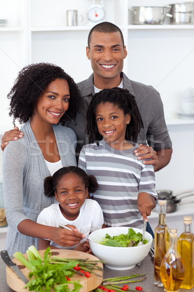Ethnic family preparing salad together Stock photo © wavebreak_media