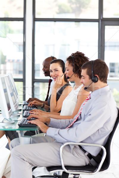 Attractive businesswoman in a call center Stock photo © wavebreak_media