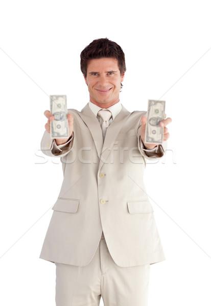 Radiant businessman showing dollars Stock photo © wavebreak_media
