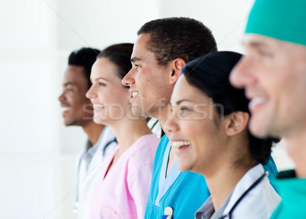 Multi-ethnic medical team standing in a line Stock photo © wavebreak_media