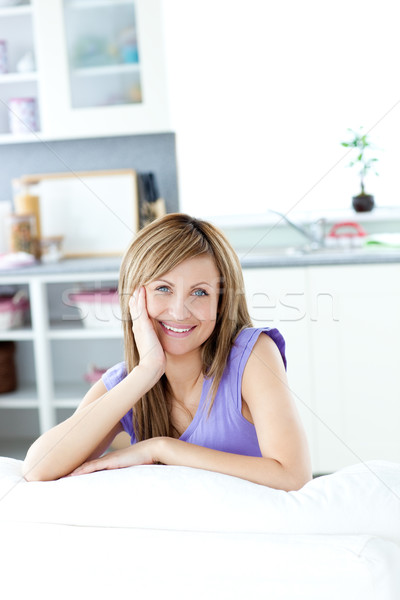 Cheerful woman looking at the camera in the kitchen Stock photo © wavebreak_media