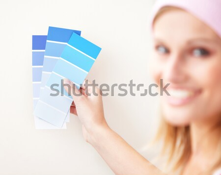 Caucasian woman choosing a color to decorate her house Stock photo © wavebreak_media