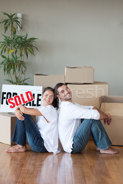 Cheerful couple sitting on the floor in their new house Stock photo © wavebreak_media