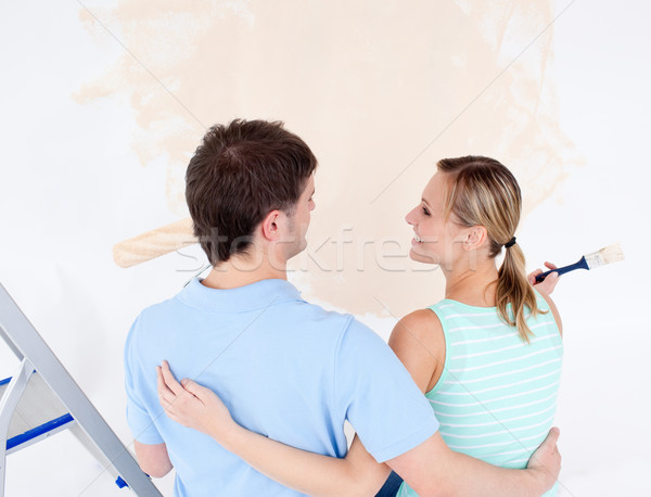 Affectionate couple painting a room in their new house  Stock photo © wavebreak_media