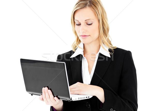 üzletasszony laptopot használ áll fehér iroda mosoly Stock fotó © wavebreak_media