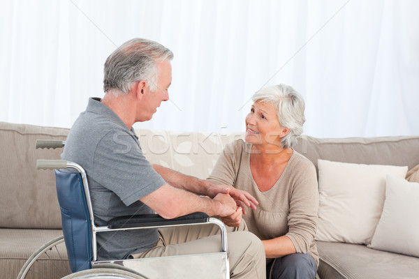 Woman with her husband in a wheelchair Stock photo © wavebreak_media