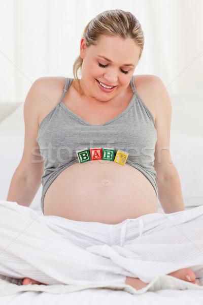 Donna incinta baby pancia home sfondo Foto d'archivio © wavebreak_media
