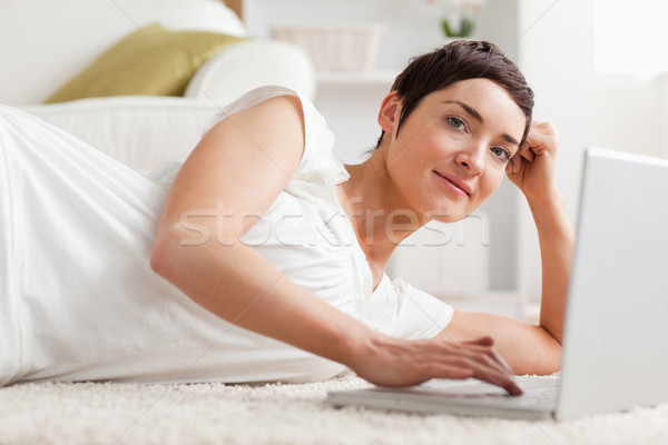 Close up of a quiet woman with a laptop in her living room Stock photo © wavebreak_media