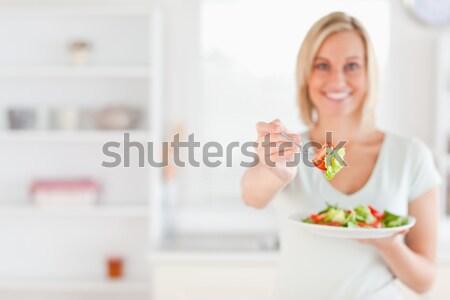 Portré nő paradicsom kamera fókusz előtér Stock fotó © wavebreak_media