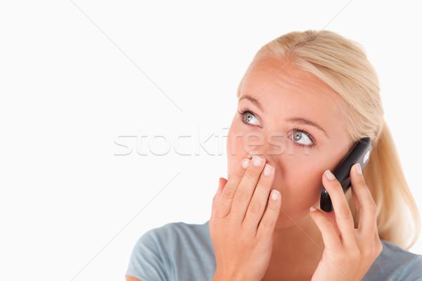 Megrémült nő telefonál stúdió mosoly boldog divat Stock fotó © wavebreak_media