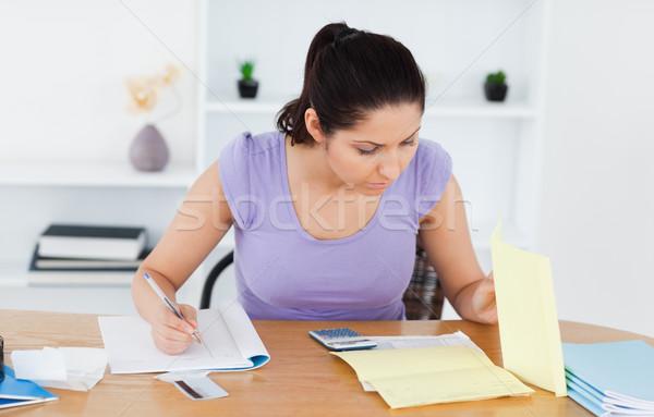 учета Жилье женщину бумаги работу Сток-фото © wavebreak_media