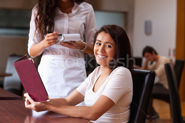 Smiling woman ordering a meal in a restaurant Stock photo © wavebreak_media
