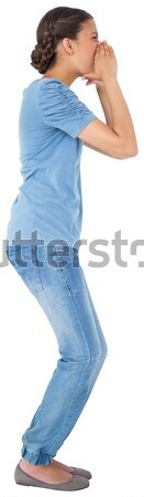 Side view of young woman with hands on her hip against a white background Stock photo © wavebreak_media