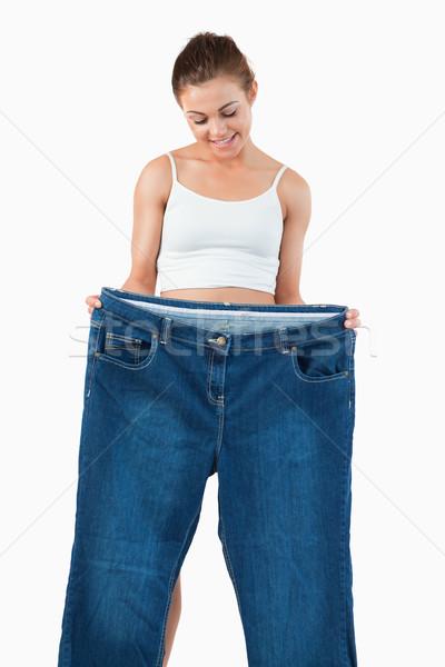 Porträt passen Frau groß Jeans Stock foto © wavebreak_media