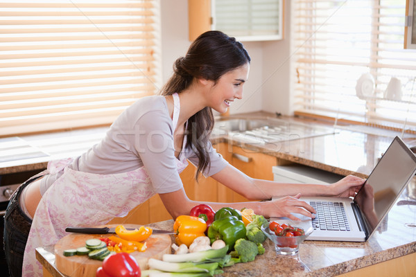 Woman looking for a recipe on the internet in her kitchen Stock photo © wavebreak_media