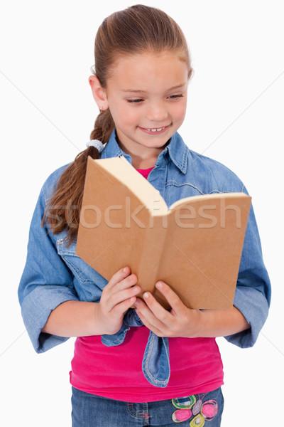 Portré higgadt lány olvas könyv fehér Stock fotó © wavebreak_media