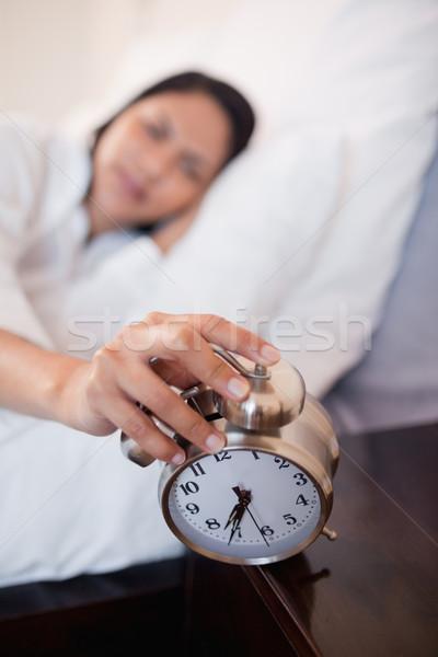 Alarm clock successfully woke up young woman Stock photo © wavebreak_media