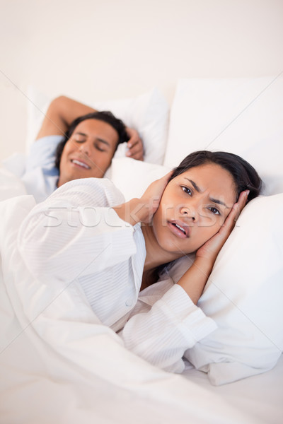 Young woman being annoyed by snoring boyfriend Stock photo © wavebreak_media