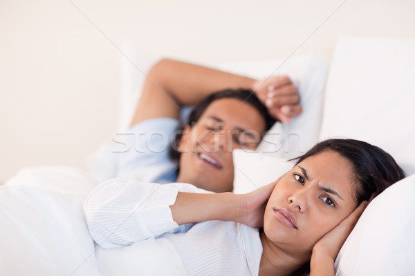 Young man waking his girlfriend with snoring Stock photo © wavebreak_media