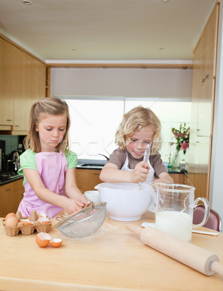 Brother and sister preparing dough together Stock photo © wavebreak_media