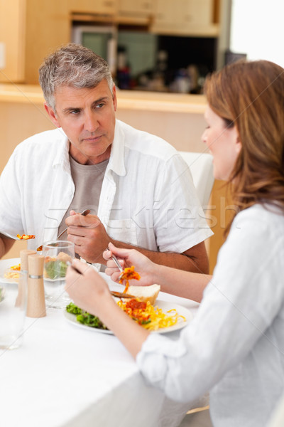Férfi beszél feleség vacsora mosoly mosolyog Stock fotó © wavebreak_media