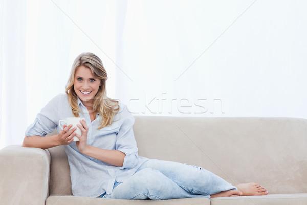 сидят диване Кубок кофе Сток-фото © wavebreak_media