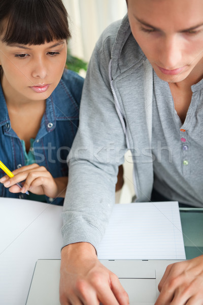 Close-up of two students doing homework with a laptop Stock photo © wavebreak_media