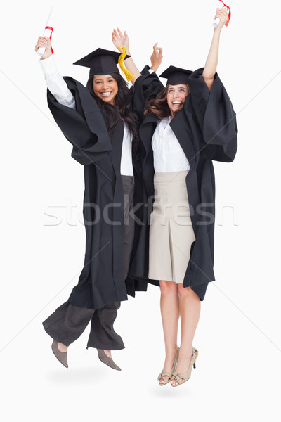 A full length shot of two women jumping in celebration after graduating  Stock photo © wavebreak_media