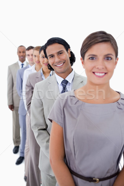 Close-up of co-workers in a single line smiling and looking straight with focus on the first man aga Stock photo © wavebreak_media