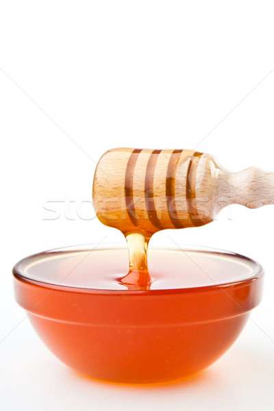 Honey dipper at horizontally  dropping a trickle of a honey Stock photo © wavebreak_media