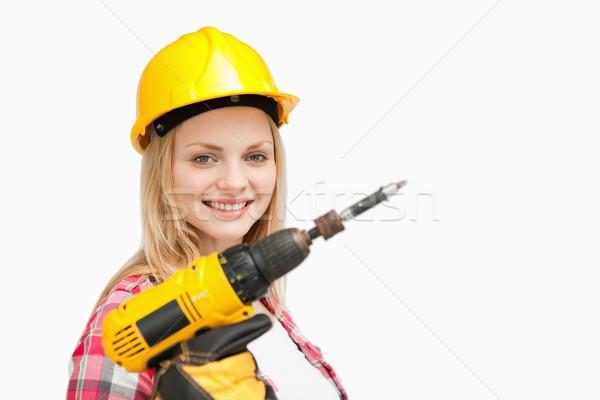 Nő tart elektromos csavarhúzó mosolyog fehér Stock fotó © wavebreak_media