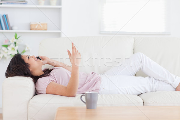Woman relaxing on a sofa while phoning Stock photo © wavebreak_media