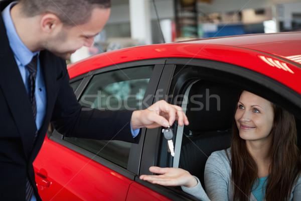 Customer receiving car keys in a dealership Stock photo © wavebreak_media