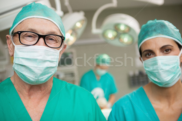 Surgeons standing up in a surgical room in a surgical roon Stock photo © wavebreak_media