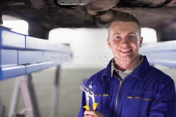 Sorridere meccanico regolabile garage auto Foto d'archivio © wavebreak_media
