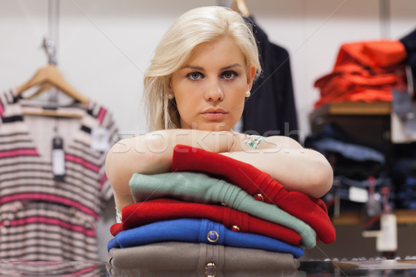 Woman is leaning on clothes in a boutique Stock photo © wavebreak_media