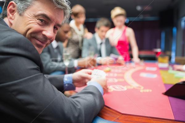 男 笑みを浮かべて ポーカー 表 カジノ 手 ストックフォト © wavebreak_media