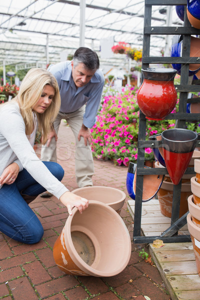 Couple looking at ceramic plant pot in garden center Stock photo © wavebreak_media