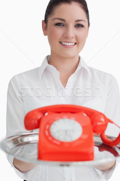 Lächelnde Frau halten Silber Fach rot Telefon Stock foto © wavebreak_media