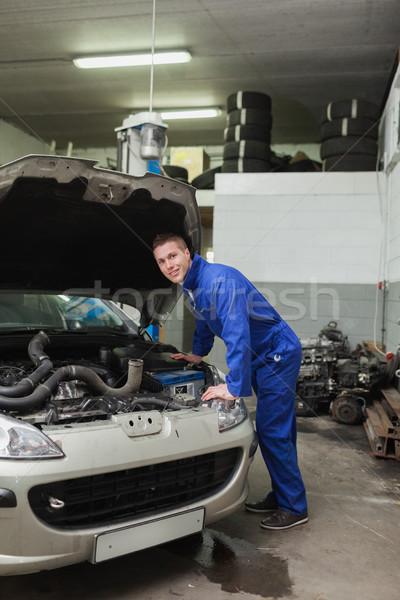 Male mechanic repairing car Stock photo © wavebreak_media