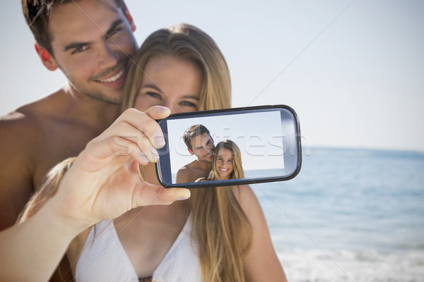 Couple taking selfie on smartphone Stock photo © wavebreak_media