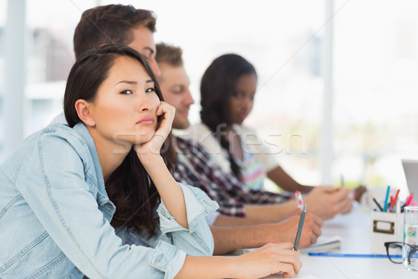 Bored woman looking at camera during a meeting Stock photo © wavebreak_media