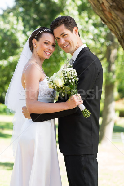 Newly wed couple with head to head in garden Stock photo © wavebreak_media