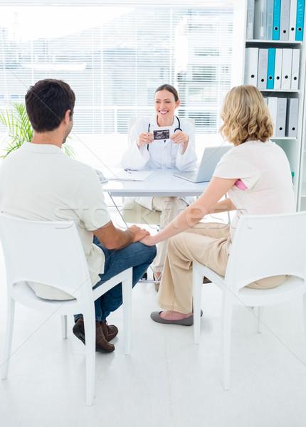 Expectant couple consulting gynaecologist Stock photo © wavebreak_media
