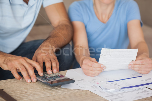 Mid section of a couple with bills and calculator Stock photo © wavebreak_media