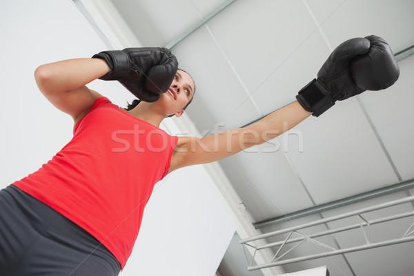 Determined female boxer focused on training at gym Stock photo © wavebreak_media